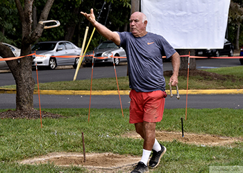 Man throwing horseshoe.