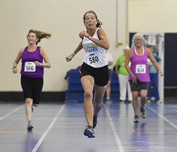 Three women running.