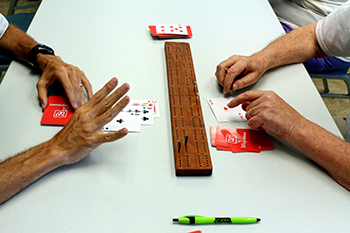 Cribbage board and cards.