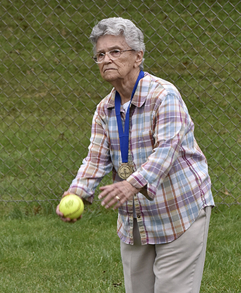 Woman throwing softball.