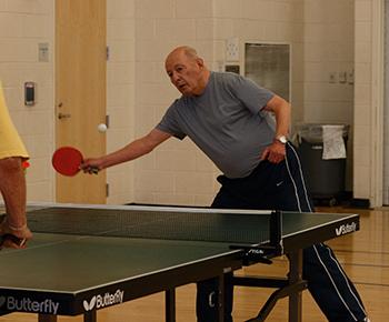 Man playing table tennis.