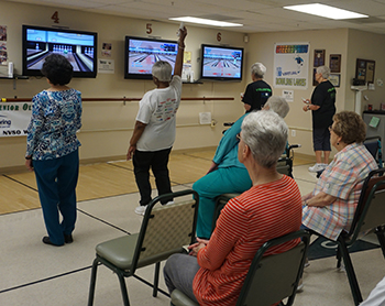 Women playing wii bowling.